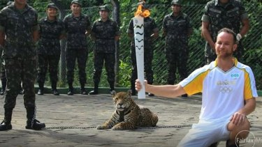 The jaguar looks on during the torch ceremony.