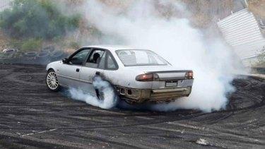 Mandurah car enthusiasts hard at work at a now defunct local burnout pad.