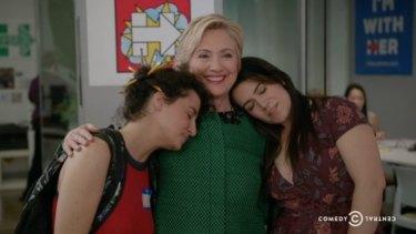 Hillary Clinton embraces Abbi Jacobson and Illana Glaser on