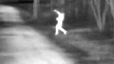 A thermal camera image of a person throwing contraband over the fence into the Outer Metropolitan Multi-Purpose Correctional Centre near Windsor.