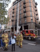 Firefighters evacuated a building hit by a blaze in a ground floor shop.
