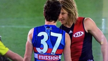Bob Murphy with Essendon's stand-in skipper Dyson Heppell at the coin toss.