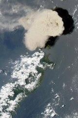 The Mount Ruang volcano erupts in 2002.