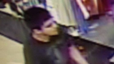 A video image shows a suspect wanted by the authorities regarding the shooting.