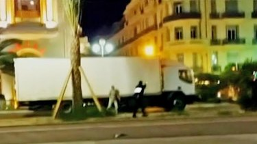 A police officer stands beside the truck which hit hundreds of people in Nice.