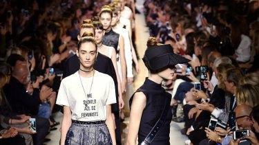 Models walk the runway at the Dior Spring Summer 2017 fashion show.