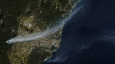 Satellite image shows the smoke from fires streaming across the Sydney Basin from fires near Warragamba Dam.