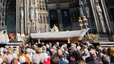 Standing in a boat recovered from Malta, Cardinal Rainer Maria Woelki told the crowd that anyone who lets people drown lets God drown.