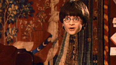 Harry Potter wears his invisible cloak in a screengrab from the popular movie series.