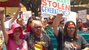 Protesters campaign against the removal of Aboriginal children.