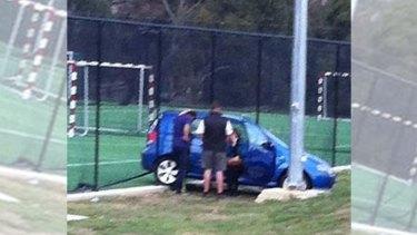 The woman in her car at Blackburn High School.