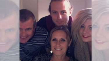 Phil Walsh, his wife Meredith and their children.