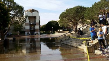 Students at UCLA kill time until the water from a burst main subsides.