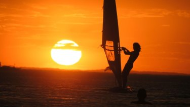A wind surfer off Elwood Beach, Port Phillip Bay, at the end of a very hot day in Melbourne.
