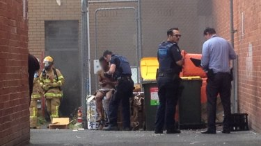 The alleged arsonist at the back of the bank.
