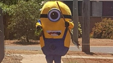 The minion makes a break for it with his prize.