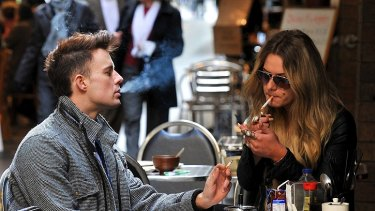 Outdoor smoking will be banned at eateries in some Melbourne laneways, but the lord mayor is calling for a city-wide ban.