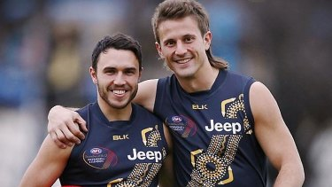 Richmond's Shane Edwards and Ivan Maric wear the Tigers' 2015 Dreamtime guernsey.