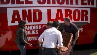 The Senator loading up the Bill Shorten election bus with furniture found on the side of the road.