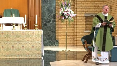 Father Walshe conducts Mass in October after returning from Ireland