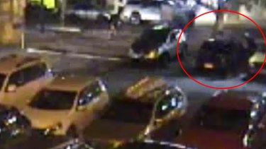 A photo from CCTV clearly shows the group of men around the car after having moved it.