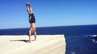 If performing a handstand on Wedding Cake Rock in Royal National Park looks dangerous, that's because it is.