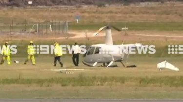 Two people have escaped serious injury after helicopter crash landed at Jandakot Airport.
