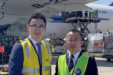 Risland Australia's CEO Dr Guotao Hu (left) farewelling 90 tons of medical supplies about to be flown to Wuhan, China.