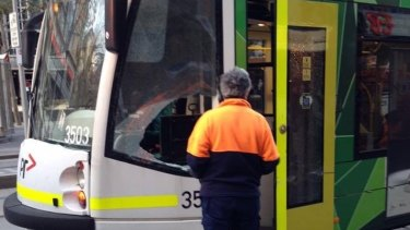 The aftermath of a collision between a tram and a horse pulling a carriage in Swanston Street on Friday.