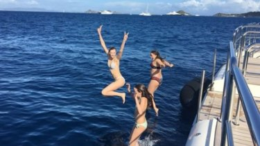 Karlie Kloss holidaying with the youngest Murdoch children, Chloe and Grace, over New Years.