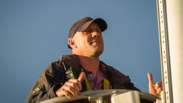 Mr Davies fights his fear of heights at the top of the 50 metre mast on Greenpeace ship, Rainbow Warrior