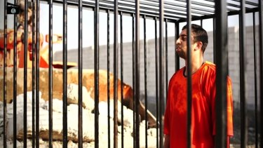 Jordanian pilot Muath al-Kasasbeh in the cage in a video released by Islamic State insurgents.