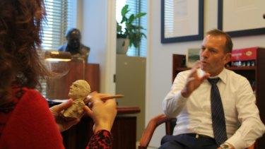 Sculptor Linda Klarfeld prepares a plasticine model of former prime minister Tony Abbott.