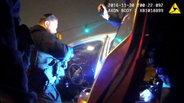 The police body camera videos were released by the lawyer of one of two people in the car who were arrested on drugs charges.