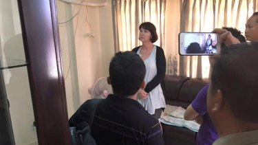Tammy Davis-Charles being questioned in the Cambodian police office of human trafficking last year.