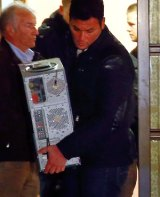 Police carry a computer out of Andreas Lubitz's house.