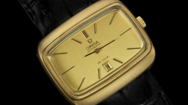 An Omega TV-shaped De Ville mens retro dress gold plated and stainless steel watch from the early 1970s.