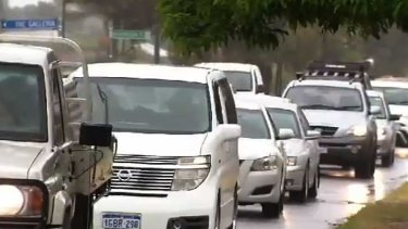 The heavy rainfall caused a commuter nightmare with sections of Perth's freeways flooding.