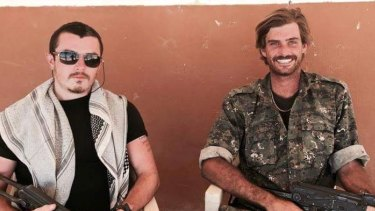 Dyball, left, is pictured here with fellow Australian Reece Harding, right, who was killed in Syria.