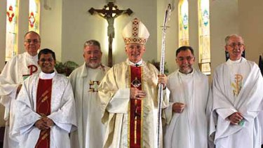 Bishop Les Tomlinson (fourth from left) with Joseph Doyle (far right), photographed more than five years after the Melbourne Response ordered Doyle to stop acting as a priest.