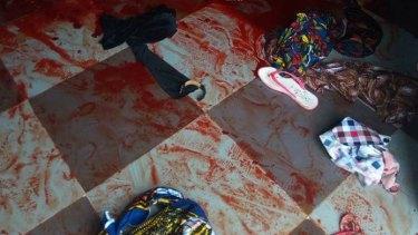 Bloody scene at the Catholic church in Ozubulu, Nigeria, after 11 people were shot dead.
