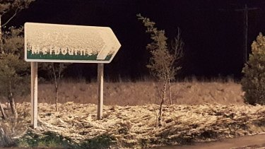 Snow-covered Melbourne sign on the Calder Freeway at Woodend.