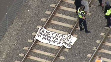 The banner left by protesters on the tracks.