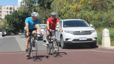 Roger Cook and Mark McGowan hit the road on their bikes
