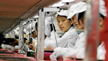 Workers are seen inside a Foxconn factory in Longhua, China in 2010. Foxconn, a major supplier of Apple was said to be improving workplace conditions.