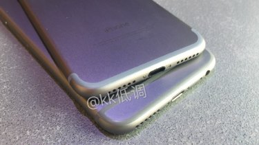 A seperate image, also posted online in July, shows a slightly different iPhone, with no headphone jack, sitting on top of an iPhone 6S.