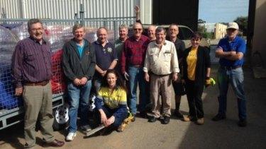 Rotary club members lending a hand.