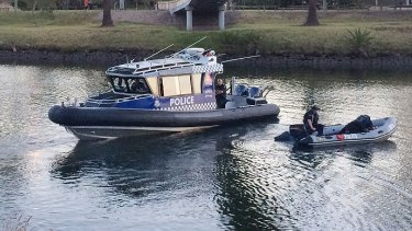 Police search the Maribyrnong River.