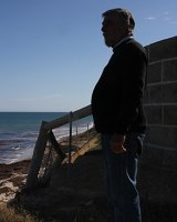 Garry Thomas at the boundary fence which is itself slipping down the dune