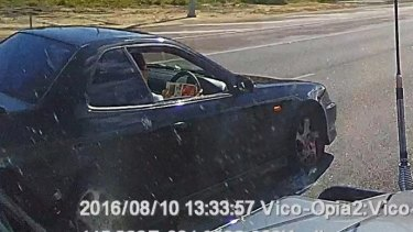 This driver was caught reading a catalogue while driving along the Mitchell Freeway in August.